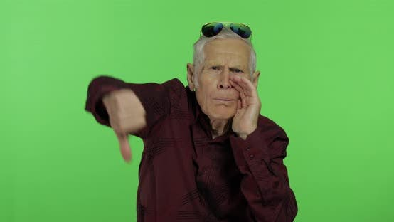 Thumbnail for Senior Man Something Giving Thumb Down. Handsome Old Man Showing Displeasure