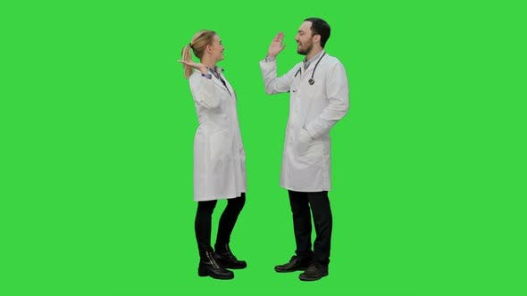 Thumbnail for Doctors Friends Give Each Other Five and Thumb Up on a Green Screen, Chroma Key.
