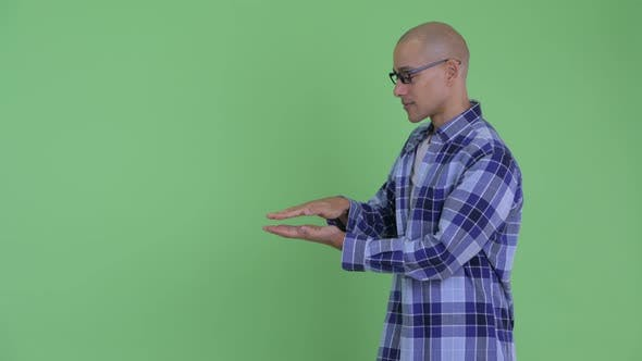 Thumbnail for Happy Bald Hipster Man Snapping Fingers and Showing Something