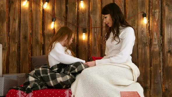 Thumbnail for Mom and Daughter Are Happily Talking and Holding Hands at Christmas Time