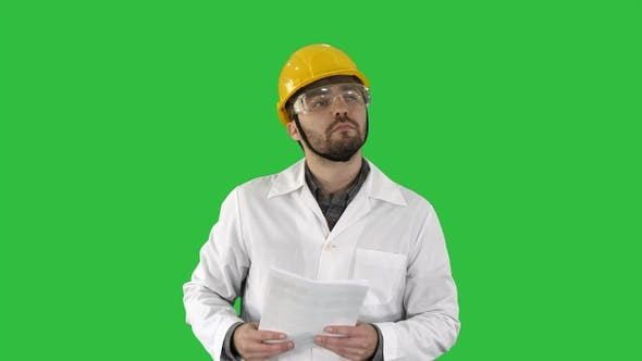 Thumbnail for Site engineer cheching papers and something around him