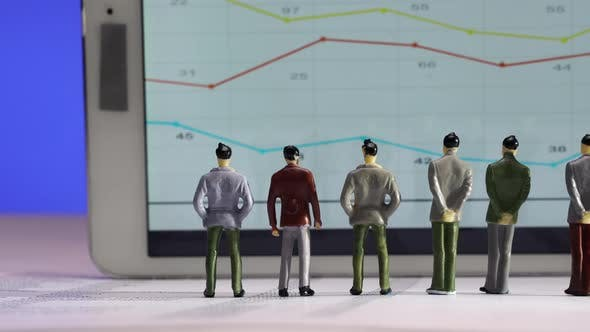 Business Figurines  Watching a Chart