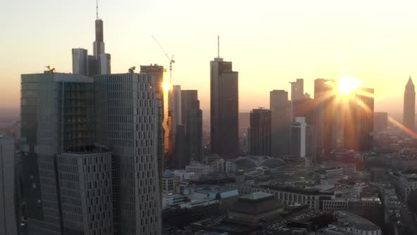 Thumbnail for AERIAL: View of Frankfurt Am Main, Germany Skyline with Sunflair Between Skyscrapers in Beautiful