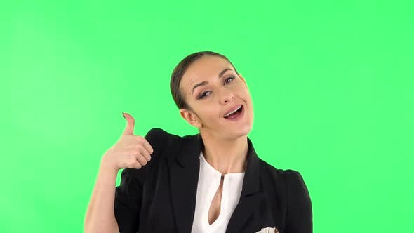 Thumbnail for Young Cheerful Woman Showing Thumbs Up, Gesture Like. Green Screen