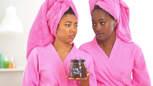 Thumbnail for Two African American friends in spa refusing spa mud