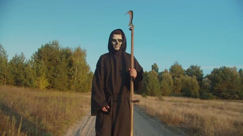 Death Reaper Frightening with Scythe on Dirt Road