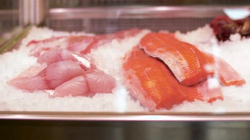 Seafood on Ice in Fridge at Fish Shop