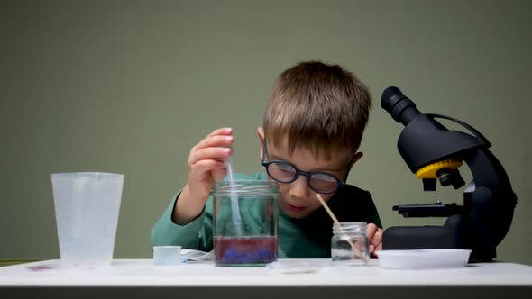 Thumbnail for Alternative Education. Kid Doing experiments.Leisure Activity Indoors. Child Playing with Reagents
