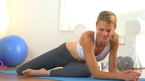 Thumbnail for Healthy blonde woman resting during exercise