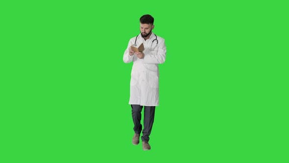 Thumbnail for Walking Doctor or Medic Man Holding Pen and Notebook Looking for Idea on a Green Screen, Chroma Key.