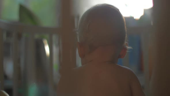 Thumbnail for A View From a Playing Baby Girls Back