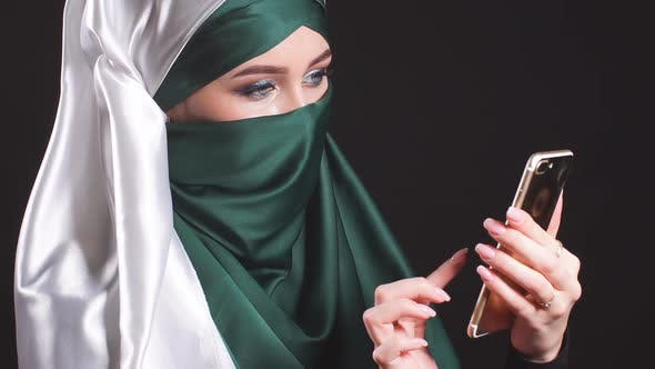Thumbnail for Portrait of Beautiful Arabic Muslim Girl Using Mobile Phone