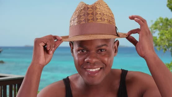 Thumbnail for Black man poses happily for a portrait by the beach