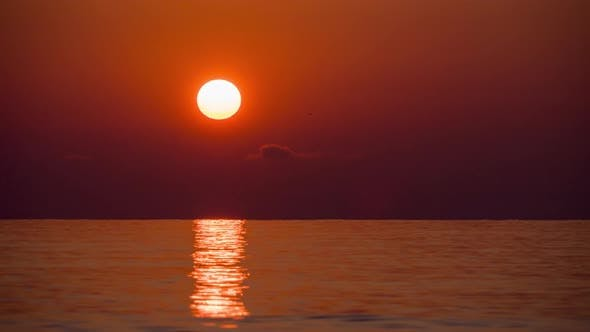 Thumbnail for Timelapse of Sunset of the Great Red Sun in the Sea. Orange Sunny Path with Sea Reflections