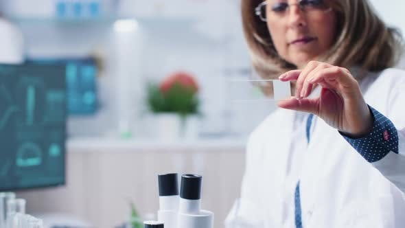 Thumbnail for Close Up of Female Biologist Holding a Bio Sample in Hands