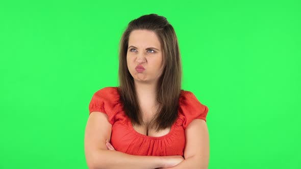 Thumbnail for Portrait of Cute Girl Is Very Offended and Looking Away . Green Screen
