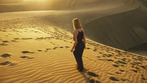 Thumbnail for Female Model Walking in Sand Dunes at Sunset