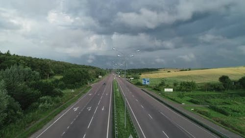 Highway On A Background Of Cloudy Sky With Low Cloud
