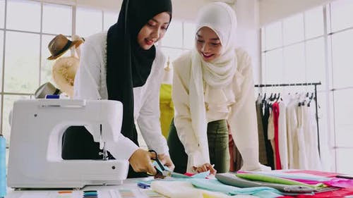Muslim women fashion designers are in process of creating new clothes collection.
