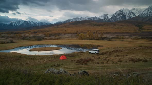 Thumbnail for Timelapse of Camping with Red Tent and Car at Mountain Lake