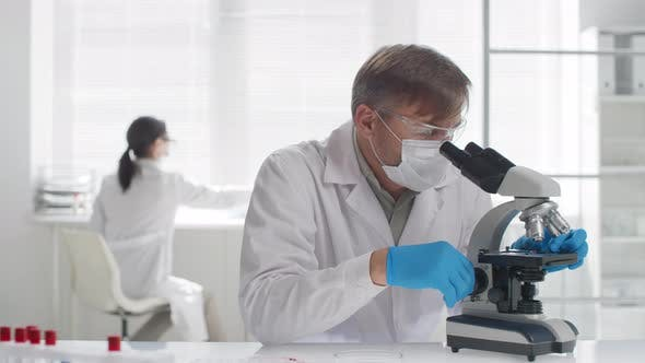 Thumbnail for Biomedical Scientist in Face Mask Working in Laboratory
