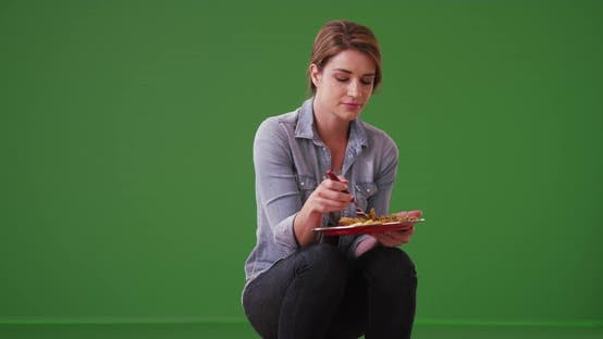 Thumbnail for Happy woman eating her meal on green screen