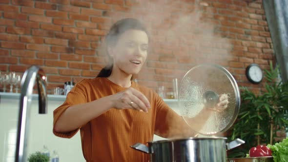 Thumbnail for Woman Making Soup in Kitchen. Girl Adding Salt To Boiling Pot.