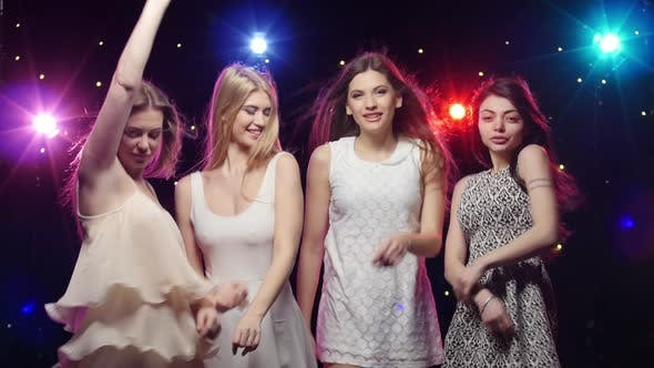 Thumbnail for Young Smiling Girls Are Dancing, Stroboscope Lamps Provide Beautiful Lighting