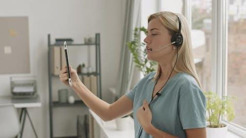 Girl Having Teleconference on Tablet