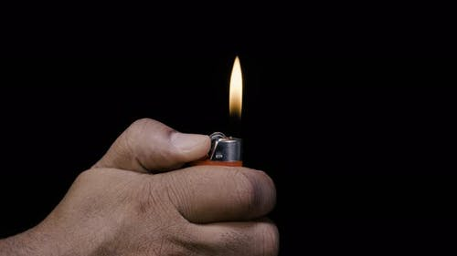 Indian Hand with a Red Lighter