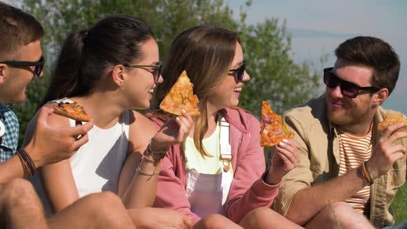 Thumbnail for Friends Eating Pizza at Picnic in Summer Park