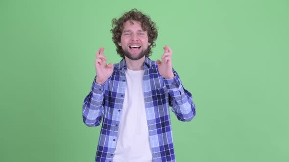 Thumbnail for Happy Young Bearded Hipster Man Wishing with Fingers Crossed