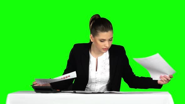 Cover Image for Young Businesswoman Overwhelmed By Too Much Paperwork in Office. Green Screen