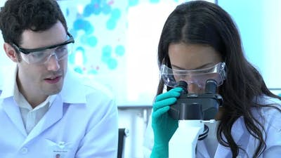 Woman looking microscope