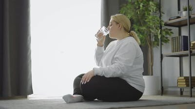Oversized Woman Refreshing After Workout