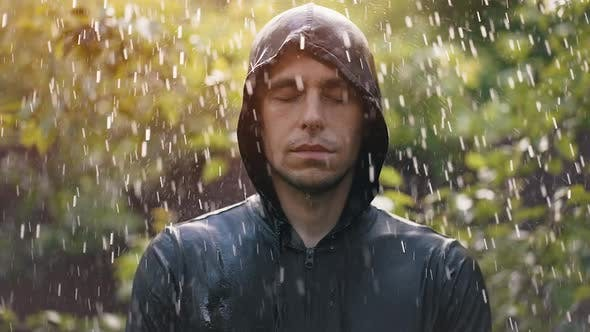 Man Stands in the Rain