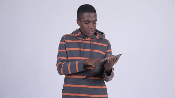 Thumbnail for Young Happy African Man Showing Clipboard and Giving Thumbs Up