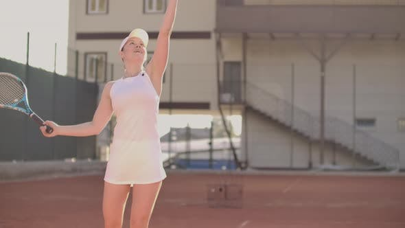 Thumbnail for Tennis Serve - Woman Tennis Player Serving Playing. Tennis Outside in Summer. Fit Female Athlete
