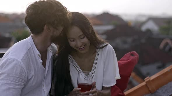 Thumbnail for Joyous Couple Smiling and Drinking Wine on Rooftop