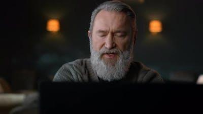 Senior Man Talking Video Call Home
