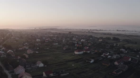 Thumbnail for Aerial Drone View Over Old Village at Sunrise. Thick Fog Covered All the Fields