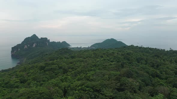 Panoramic Aerial View of Ocean Waters Forest And Clear Skies in Thailand