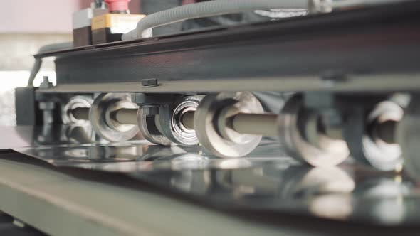 A Machine That Cuts a Metal Plate. Metal Processing in Production. Creation of Ventilation Boxes.