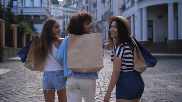 Thumbnail for Cheerful Diverse Friends Smiling While Shopping