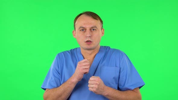 Thumbnail for Medical Man Is Very Frightened, Then Sighs in Relief. Green Screen