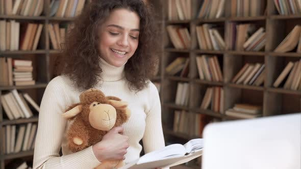 Happy Latin Woman Teacher Reading Fairytale Book Giving Online Class in Zoom