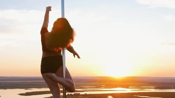 Pole Dance on Sunset - Young Woman Dancing By the Pole
