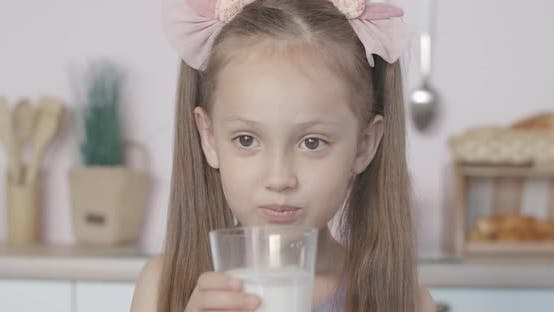 Thumbnail for Close-up Face of Cute Little Girl Drinking Milk and Smiling. Portrait of Satisfied Caucasian