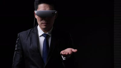 Businessman wearing VR glassese
