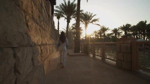 Following a Woman on Riverfront in Luxury Neighborhood in Dubai